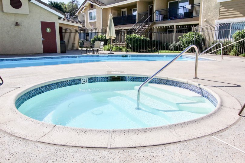Play in the pool and relax in the hot tub at Heritage at Canyon Point.