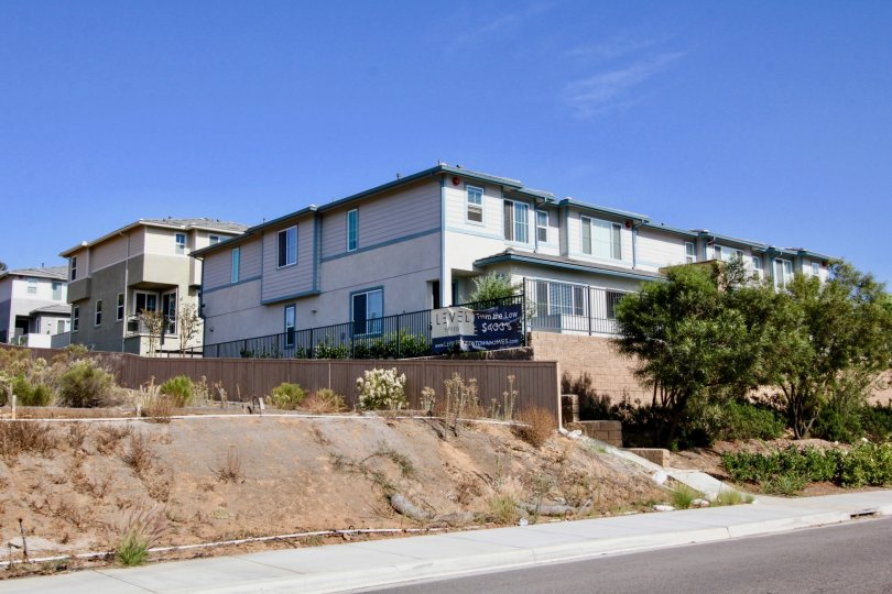 Two story residential buildings with security fence at Level Fifteen in Escondido California