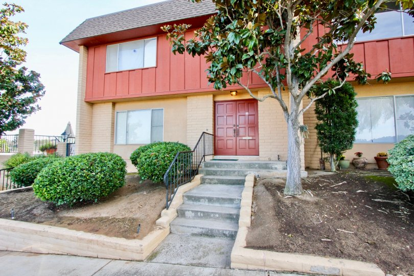 Two story housing unit with stairway leading up to it's entrance at Monte Cristo Villas in Escondido California