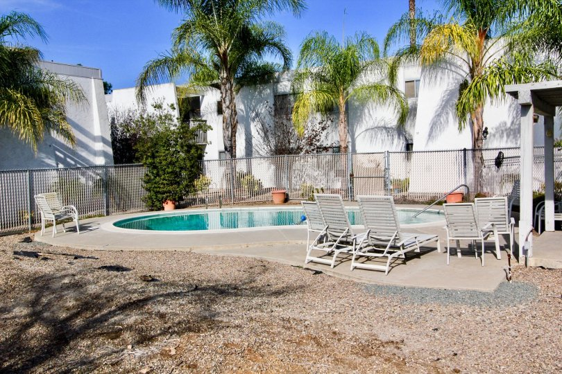 Swimming pool below housing units at Monterey Cypressnin Escondido CA