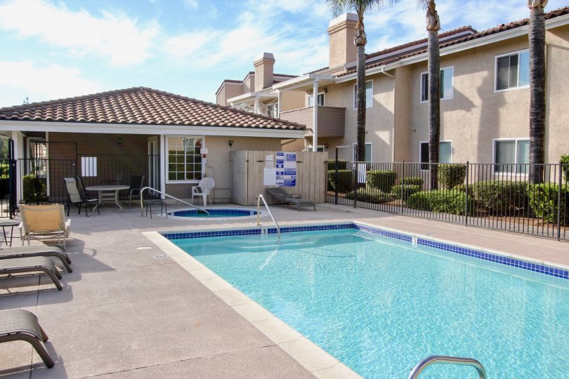 Swimming pool and sunning area near housing units at Mountain View Villas in Escondido California