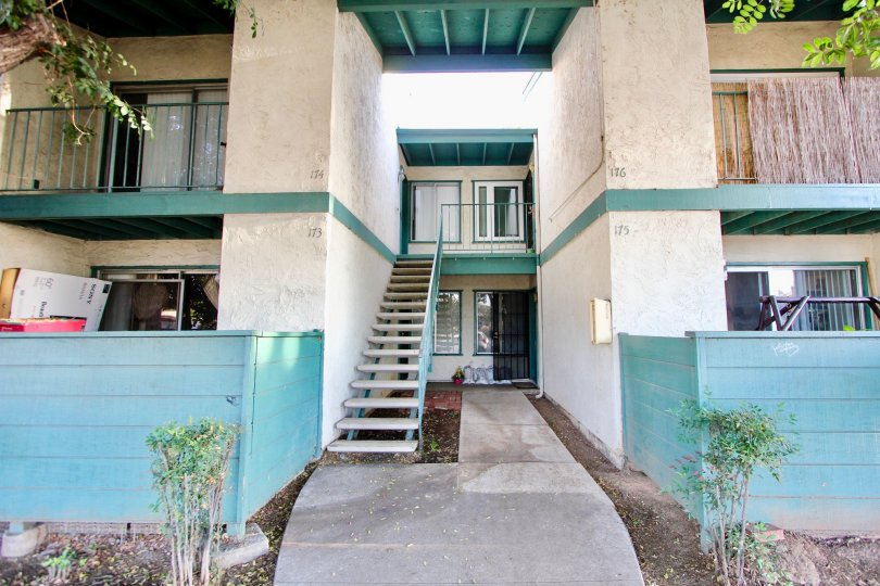 Two story residential building with attached stairway at Pepperwood Meadows in Escondido California