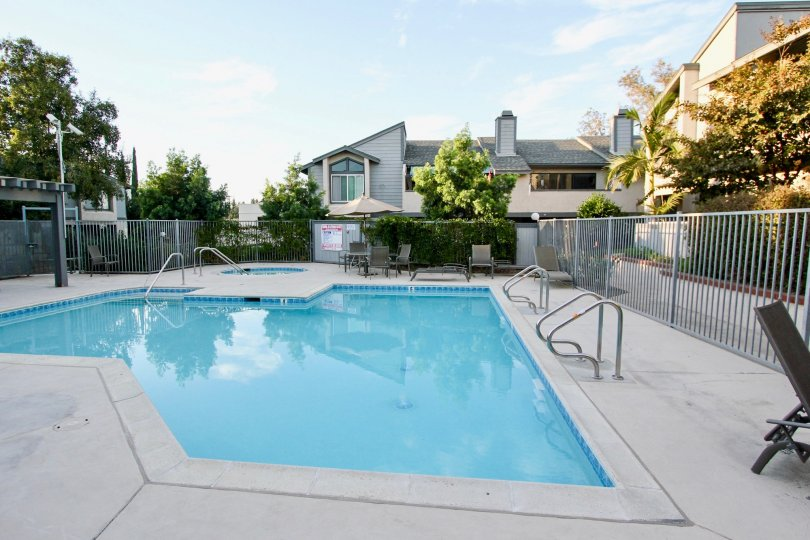 Swimming pool surrounded by residential buildings at Quarry Glen in Escondido Califonia