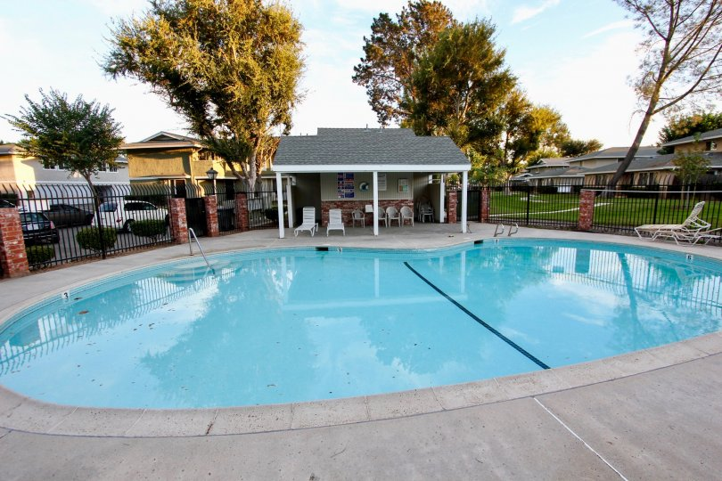 Shadow Mountain community Escondido California pool covered seating lounge chairs fence parking trees grass landscaping