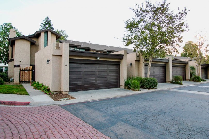 Driveway and housing with attached garages at Skylark Terrace in Escondido California