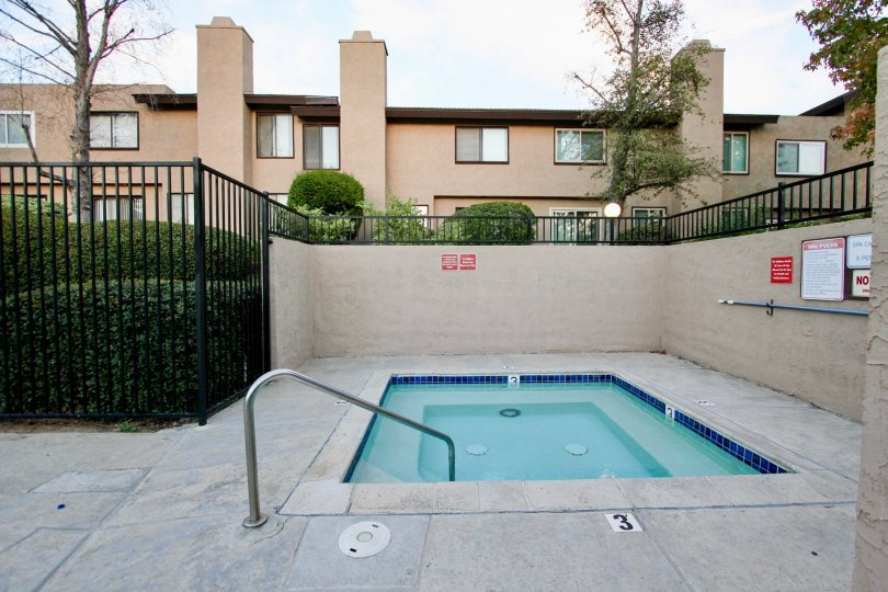 Gated Spa Pool at Skaylark Terrace, Escondido surrounded with green hedges