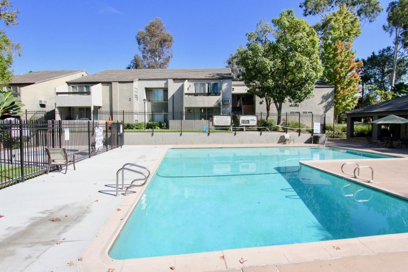 Large swimming pool that is surrounded by Townhomes in Sommerset Villas California