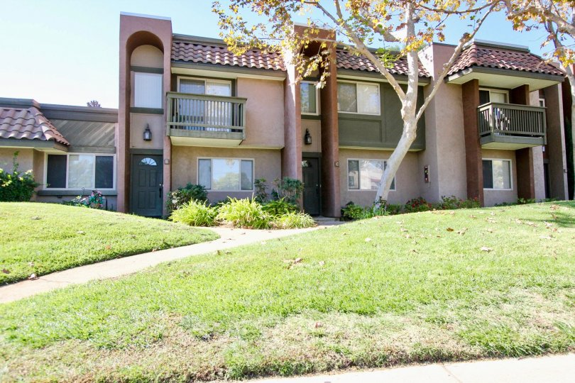Two-story condos with balconies, sidewalks and lawn, located in Sommerset Woods, Escondido, California.