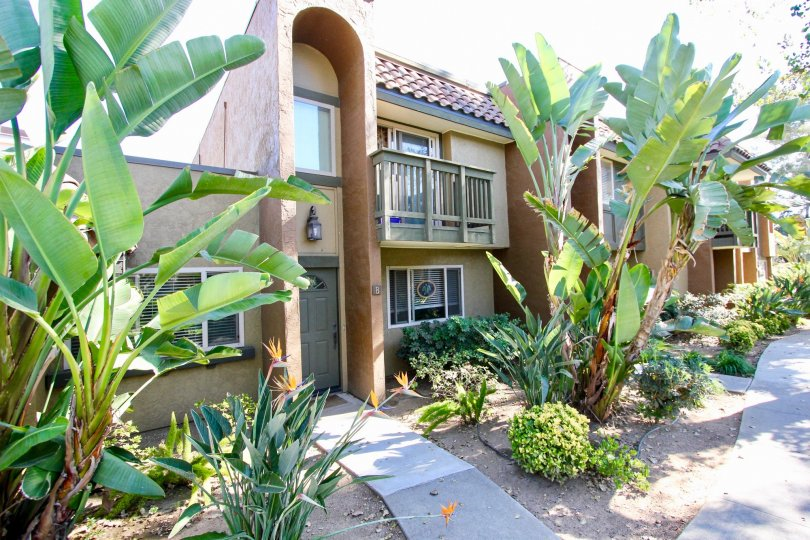 Two story residential units with lush green landscape at Sommerset Woods in Escondido California