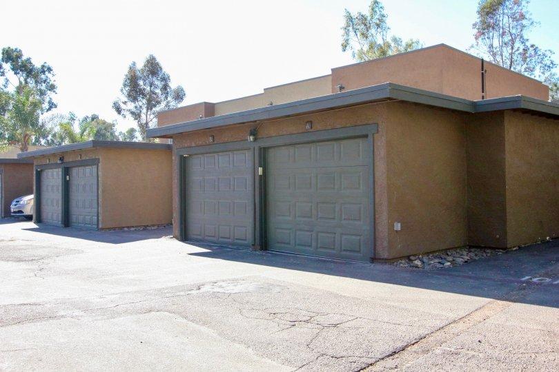 A couple of garages with gray doors in Sommerset Woods neighborhood