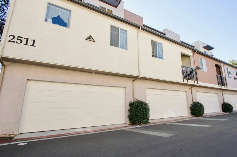 Two story residential buildings with attached garages at Urbana At Citracado Village in Escondido California