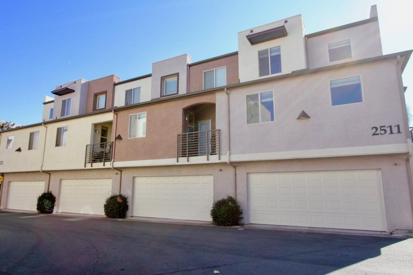Three-story condos with separate garages, located in Urbana at Citracado Village, Escondido, California.