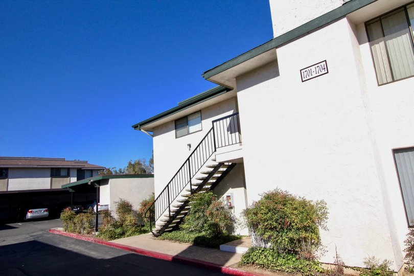 Two story housing structure near driveway at Vermont Villas in Escondido California