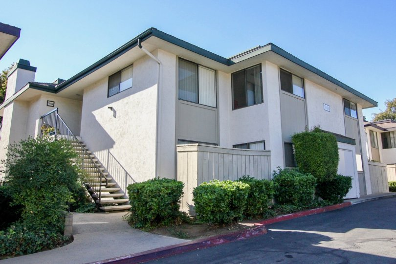 Two story housing with attached stairway near driveway at Vermont villas in Escondido California