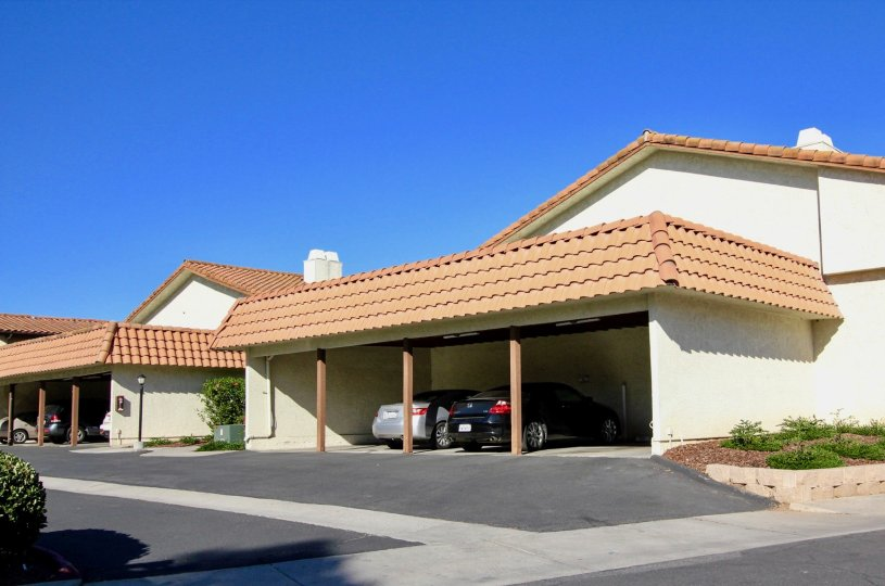 A garage carport with 2 cars in Villa Espanas, Escondido, CA