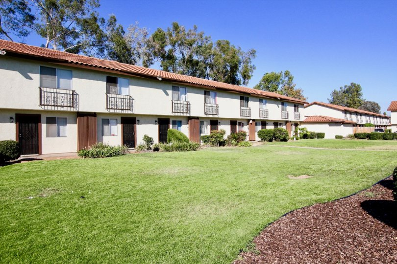 Town-homes next to lush green yard at Villa Espanas in Escondido California