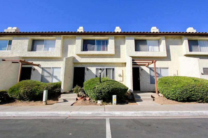 Front doors to apartments and walkways to Villas Espanas in Escondido, Ca.