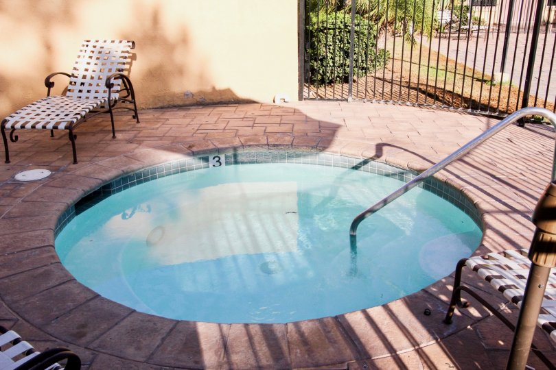 Hot tub surrounded by black security fence at Villa La Paz in Escondido California