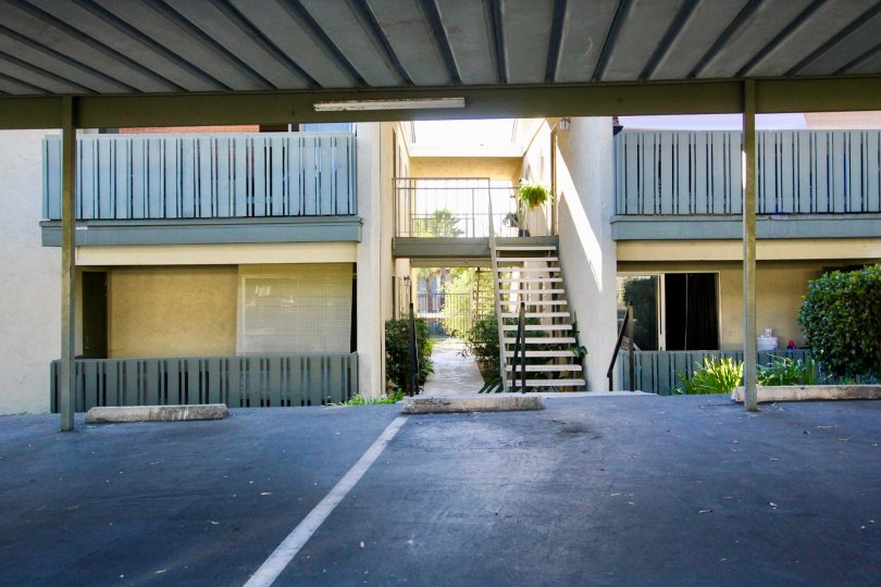 Covered parking in front of two story residential buildings at Village green in Escondido California