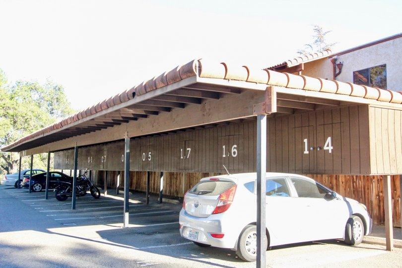 white hatchback is parked under a carport at Vista Del Mundo condos