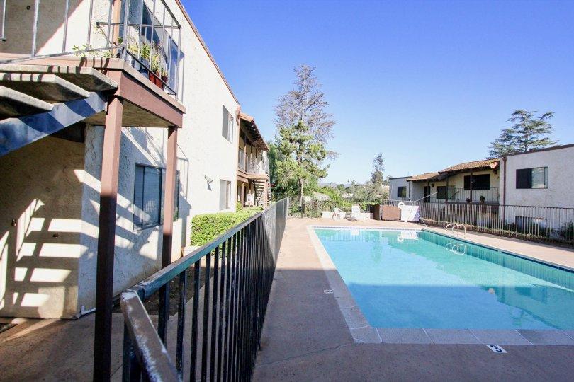 An empty pool in-between houses in Vista del Mundo village.