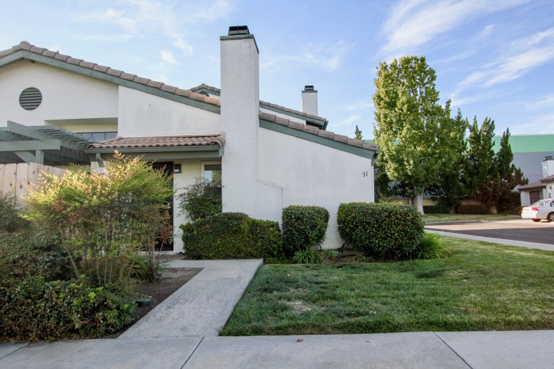 Sidwalk leading up to residence next to a green yard at Westwinds I in Escondido California