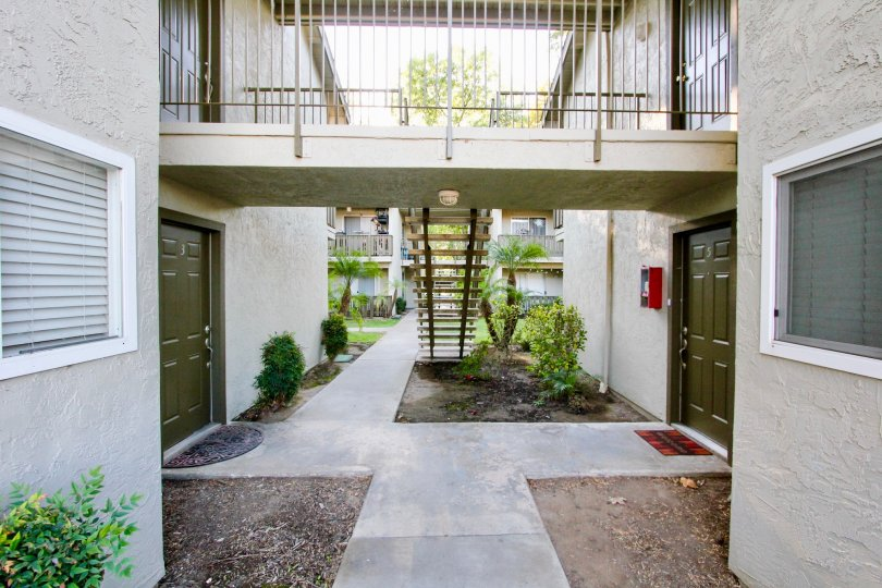 Walkway near residential buildings with attached stairway at White Oak Estates in Escondido California