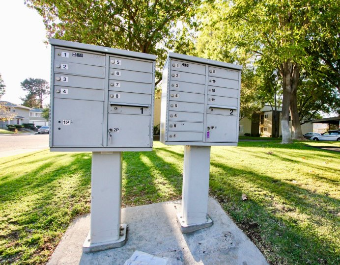 Community mailboxes located on a large plot of green space in White Oak Estates