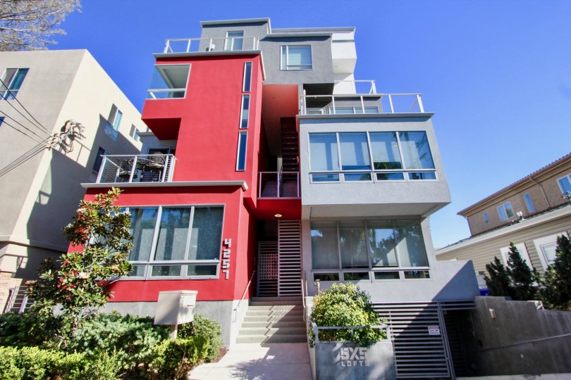 A contemporary three-storey residence painted in red and gray in the 5x5 Lofts community.