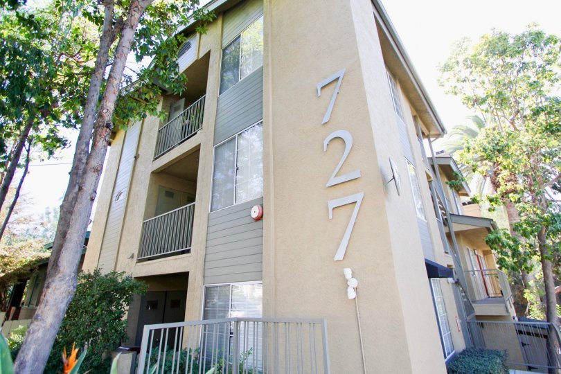 A large building with two levels with balconies and the number 727 at 727 Robinson community.