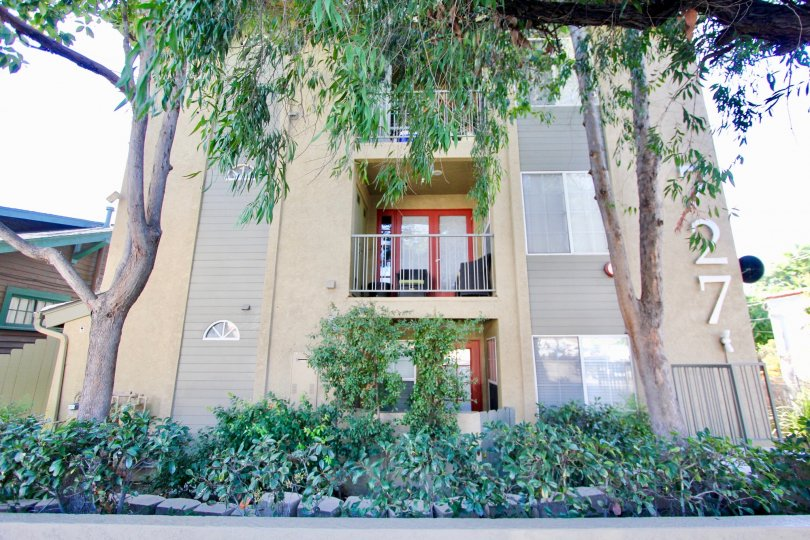 727 Robinson multi-story beige building with patios Hillcrest California