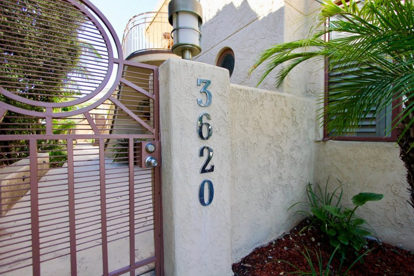 An entrance of a building in the Balboa Court with beautiful gate.
