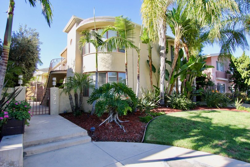 A residence with a curved corner and low gate in the Balboa Court community.