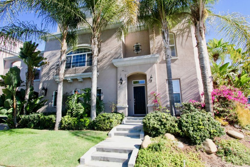 Palm trees, expert landscape, and a beautiful home to top it off at Bristol Square makes anyone want to be in Hillcrest California