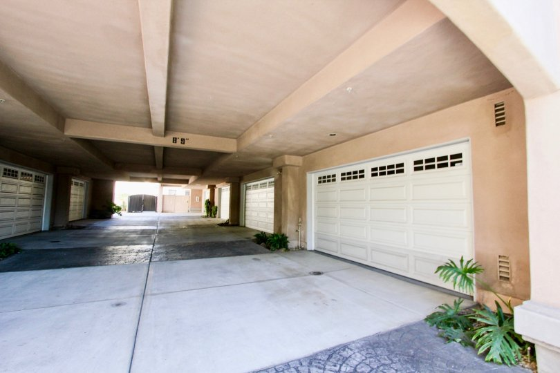 ceiling on top and garage doors on both sides with the straight path leading inside