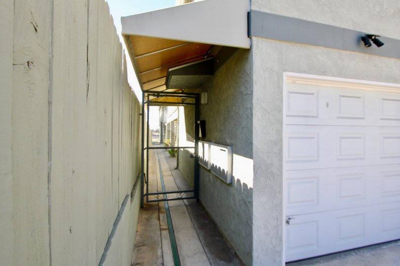 THE VILLAS IN THE CAMPUS VILLAS WITH THE PATHWAY, GATE, ELECTRIC BOX
