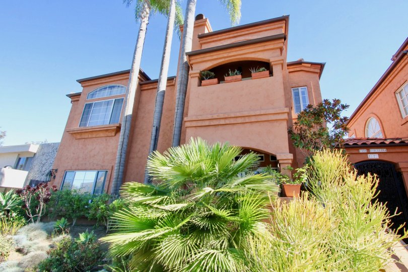 Casa Barcelona two-story brown orange building with landscaping Hillcrest California