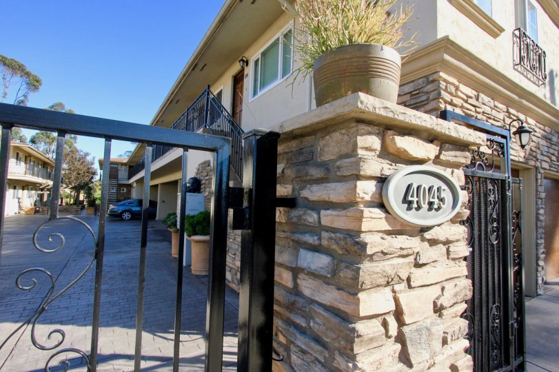 Front gate and parking area at the Hillcrest 19 community in Hillcrest, California
