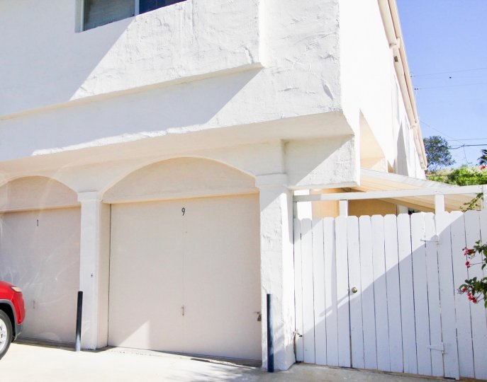 Bright sunny day of La Pacifica with a House with parking and gate in Hillcrst
