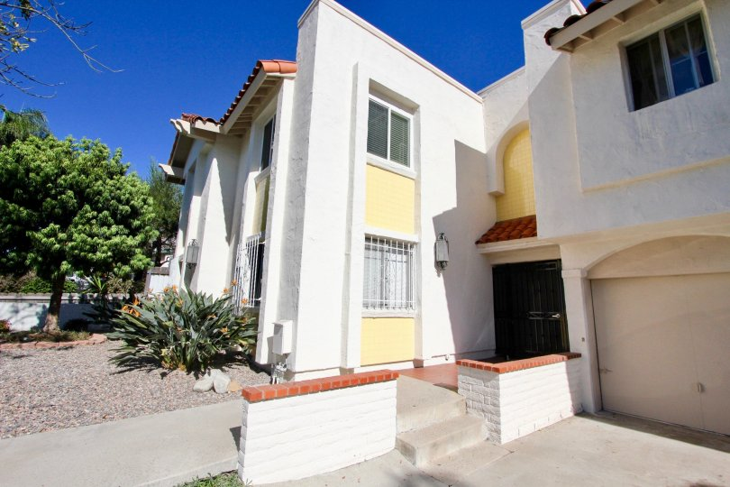 A two-storey residence painted in white and yellow in La Pacifica neighborhood.