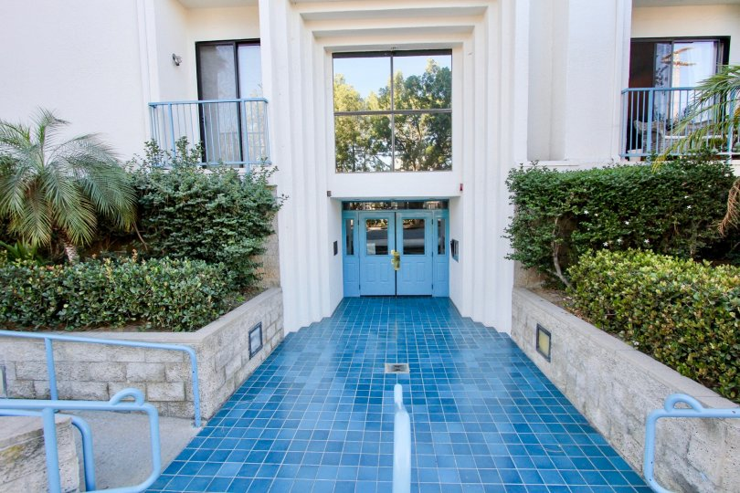 The Floor of pathway to the Apartment is made with blue marbles in Le Parc Chateau