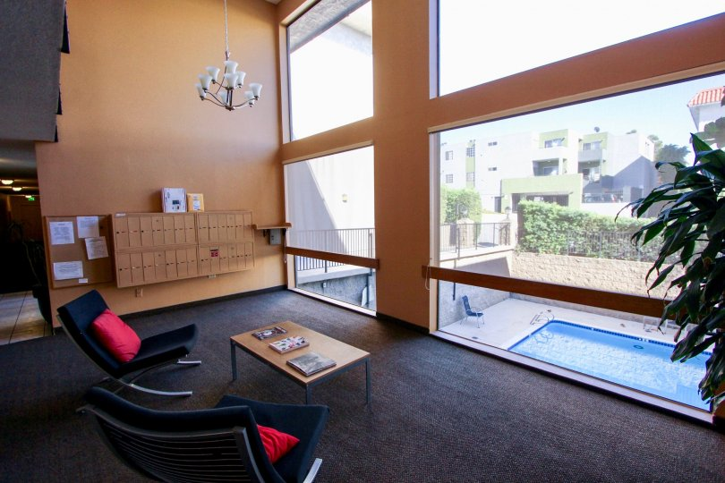 THE APARTMENT IN THE MISSION CREST GARDENS WITH THE TABLES, SWIMMING POOL, GLASS DOOR