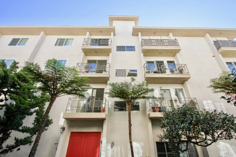 Park Royal multistory creme building with trees Hillcrest California