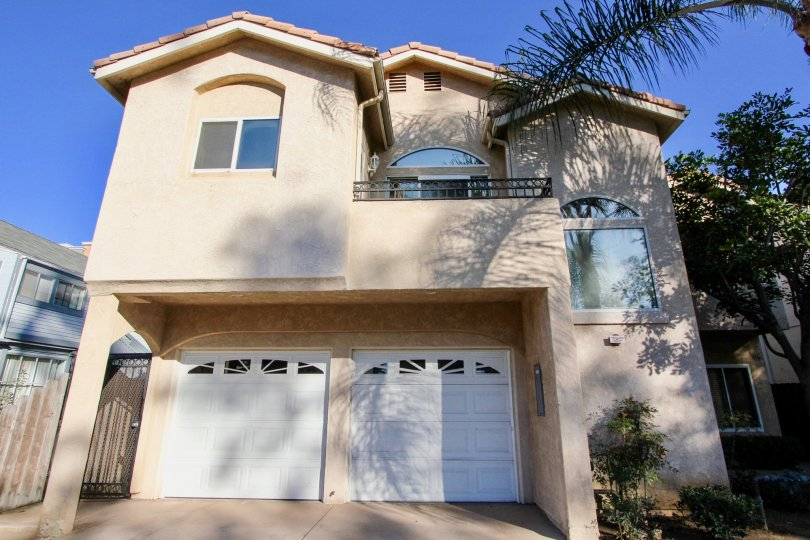 A two story pink Peniel residential building in HIllcrest CA