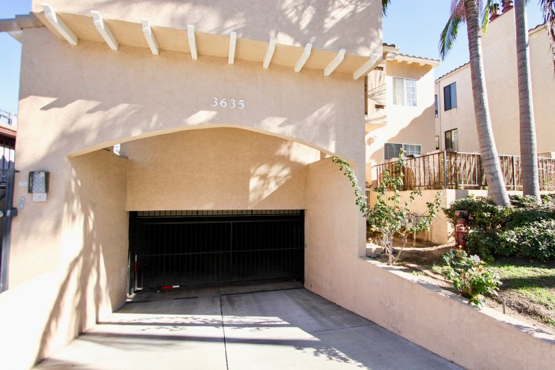 The entrance to an underground parking with decorative eaves in the Third Avenue Condos community.