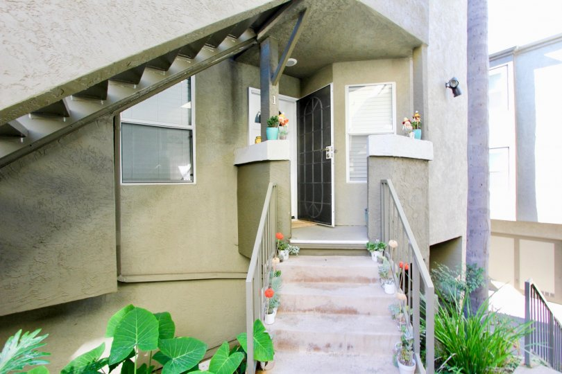 Steps up to the entrance of a unit at Uptown Villas West in Hillcrest California