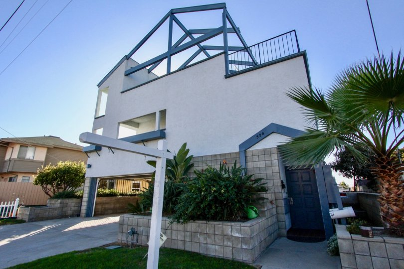 Three story housing with blue door at Alejandra in Imperial Beach California