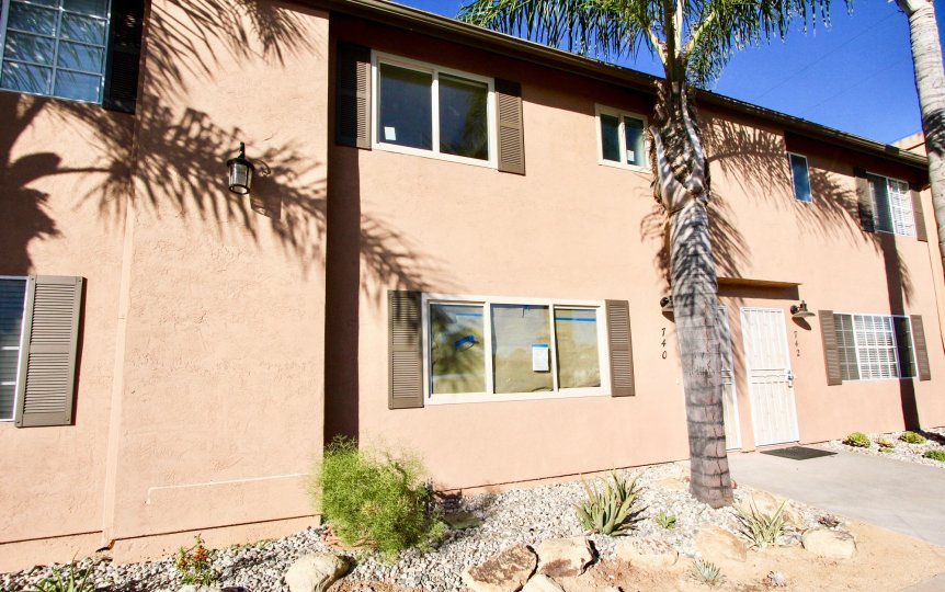 Two story residential building with palm trees at Cherry Breeze in Imperial Beach California