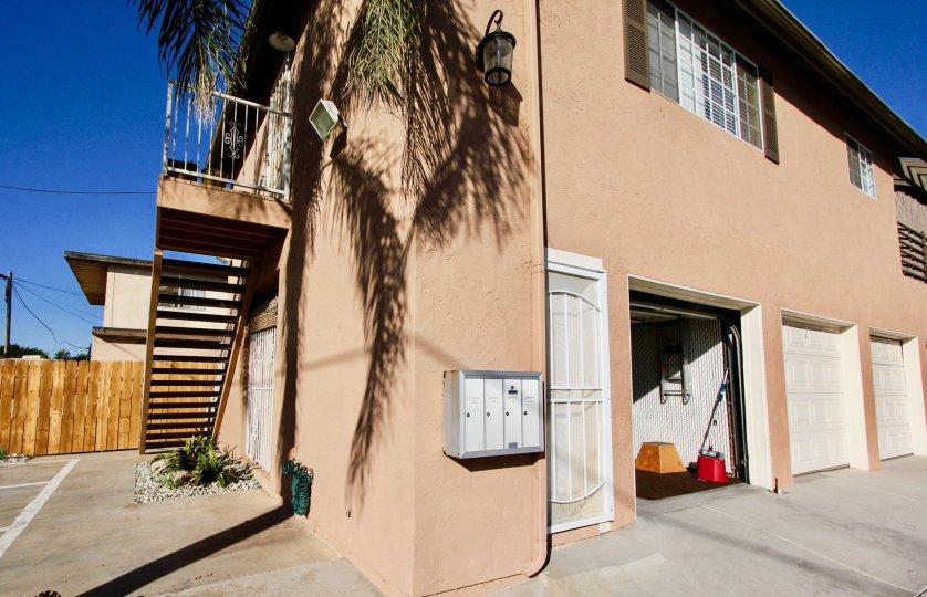 An open garage door on the Cherry breeze apartment building