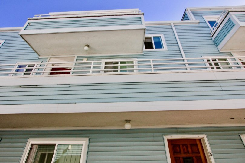 A sunny day in Coastwalk Townhomes has villa door with number 6